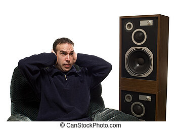 Loud Music - Young man listening to loud music, isolated...