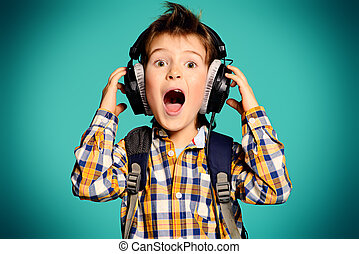 loud music - Cute 7 year old boy listening to music on...