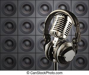 Professional ''Retro'' Microphone & DJ Headphones In Spotlight Against The Wall Of Speakers