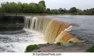 Loud noise as the bog swamp water falls on the waterfalls -...