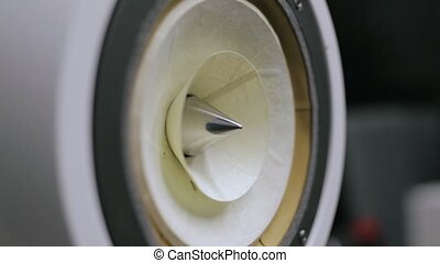 Loud Speaker in Action. Closeup at moving sub-woofer....