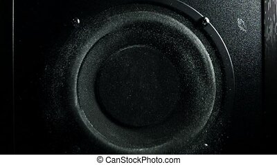 Loud speaker throws dust in the air. Super slow motion. Equalizer concept