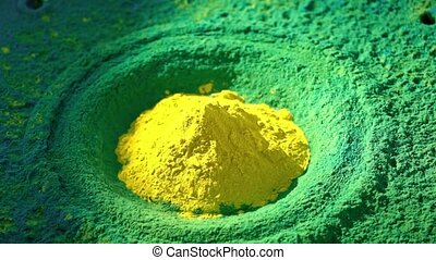 Loudspeaker throws yellow and green powder in the air, super...