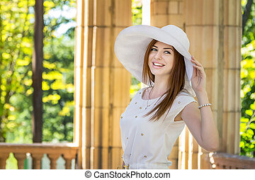 Loughing woman in white hat - Beautiful loughing young woman...
