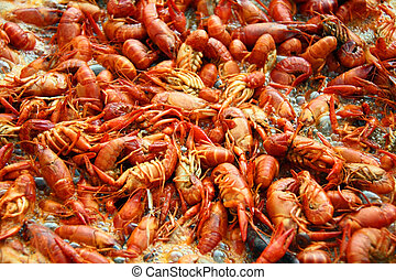 Louisiana crawfish boiling in a pot of spicy water.