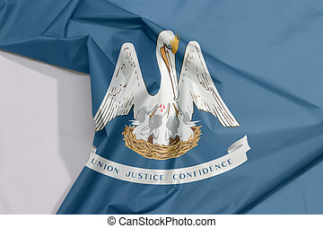 """Louisiana fabric flag crepe and crease with white space. A mother pelican """"in her nest feeding her young with her blood"""" on an azure field with state motto."""