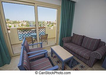 Lounge area of luxury hotel resort room