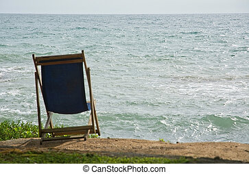 Lounge chair on sandy beach