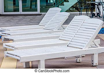 lounge chairs near swimming pool