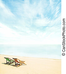 Lounge chairs on a beach - Lounge chairs on a tropical beach...