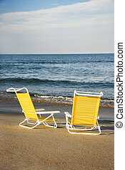 Lounge chairs on beach.