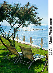Lounge chairs on the beach at Greek hotel