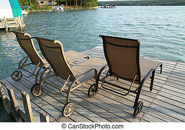 Lounge chairs sitting on a dock