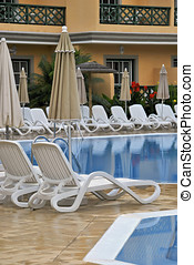 Lounge chairs in the pool. Tranquil scene