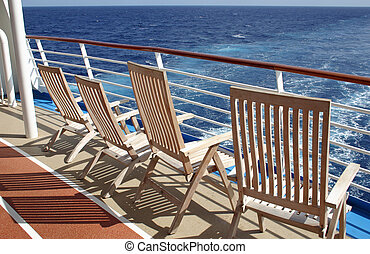 Lounge Chairs - Empty lounge chairs on the stern of a cruise...