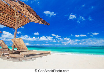 Lounge chairs under tent on beach - Vacation holidays...