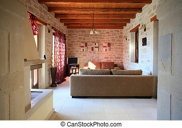 The sitting room of a luxury Greek villa on the island of Crete, used for holiday lets