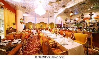 Lounge of restaurant is filled with sofas in east style -...