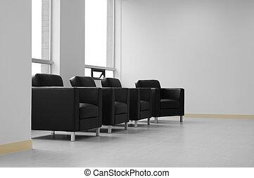 Lounge. - Black sofas.