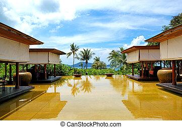 Lounge pool view area at luxury hotel, Phuket, Thailand
