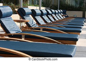 Lounge - Poolside lounge chairs.
