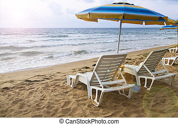 lounger parasol beach sea sky