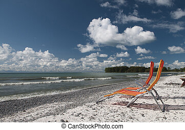 Lounging on Lake Ontario - Two lounging chairs on the beach ...