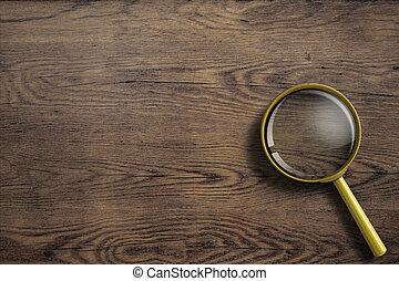 loupe, de madera, o, mesa de vidrio, aumentar