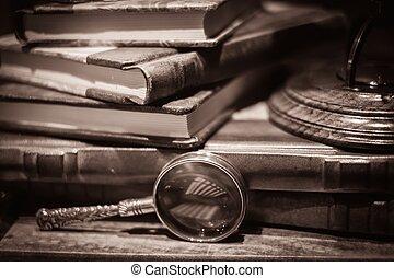 Loupe near vintage books