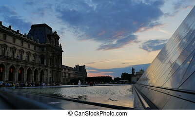 louvre low angle pyramid sunset - Paris july 01:people...