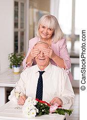 Lovable joyful lady surprising her man
