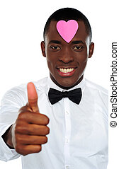 Love african boy gesturing thumbs-up