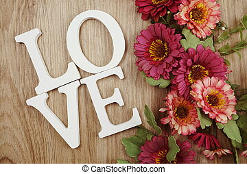 LOVE alphabet letters with space copy on wooden background