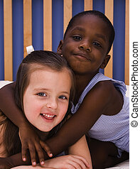 Love and Acceptance - A young African American child hugs a...
