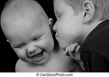 Love and Affection - Boy kissing his baby sister