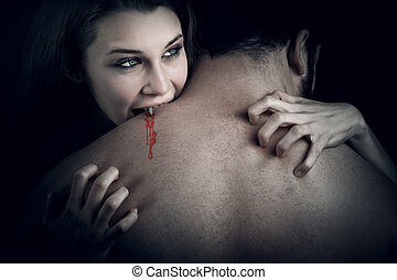 Love and blood - vampire woman biting her lover - Love and...