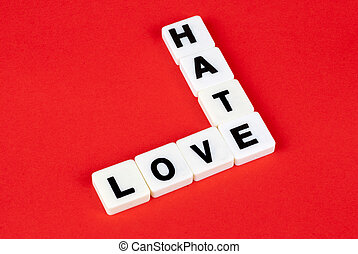love and hate words on red background