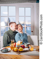 love and holiday concept. happy young couple having dinner at home