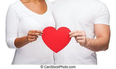 closeup of couple hands with heart