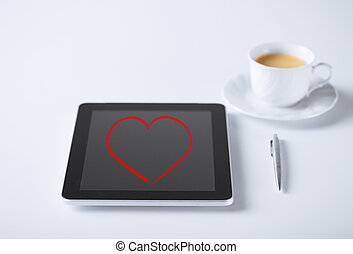 tablet pc and pen with cup of coffee