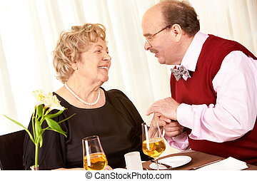 Love anytime - Portrait of mature man holding woman?s hand ...