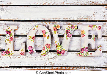 love background with decoupage decorated letters with rose pattern
