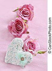 love background with knitted heart and roses
