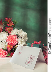 Love background with pink roses, flowers, gift on table -...