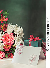 Love background with pink roses, flowers, gift on table