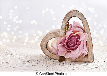 love background with wooden heart and pink rose