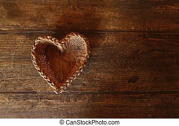 Love basket - Handmade basket in heart shape on wooden table