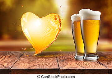 Love beer. Beer in glass with heart splash on wooden table...