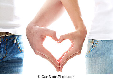 Love between us - Conceptual image of female and male hands ...