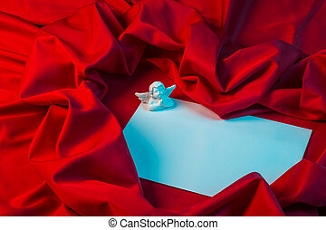 love card with angel on a red fabric - love card. white...